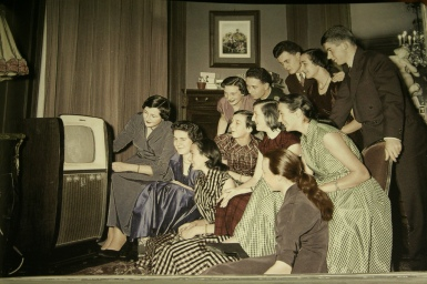 Family in front of a television set, France, ca_ 1950s